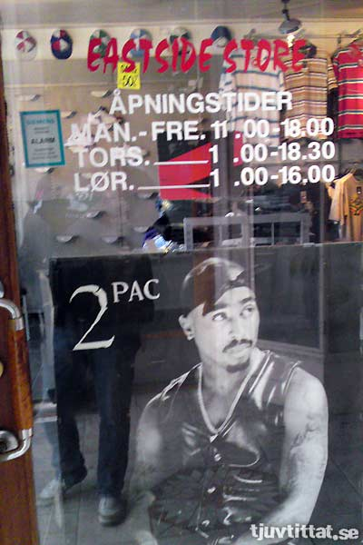 2pac, hero of the West Coast, hides in an East Side store...